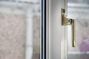 White uPVC Window with golden handle